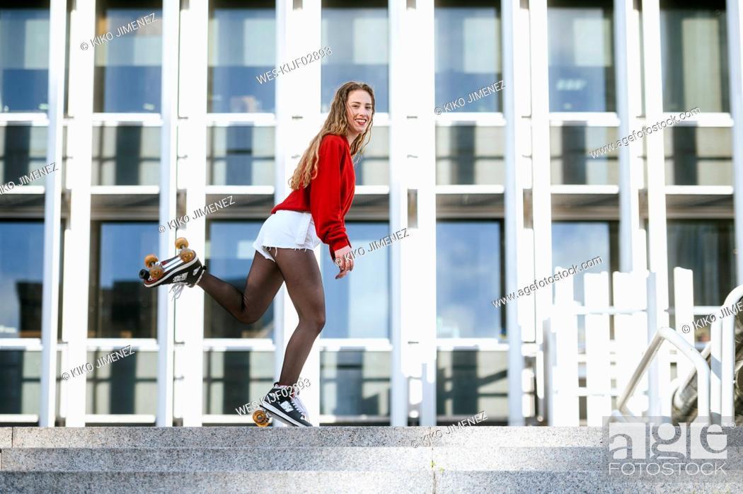 Photo de stock: Blond woman balancing with roller skates.