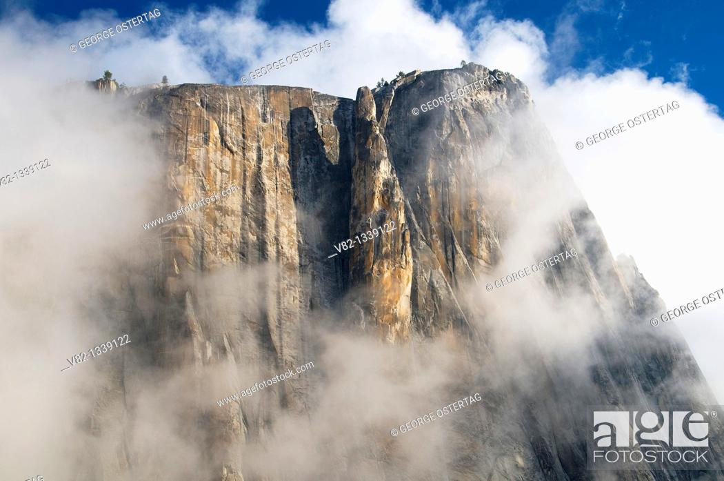 Stock Photo: Cliff in clouds from Yosemite Falls Trail, Yosemite National Park, CA.