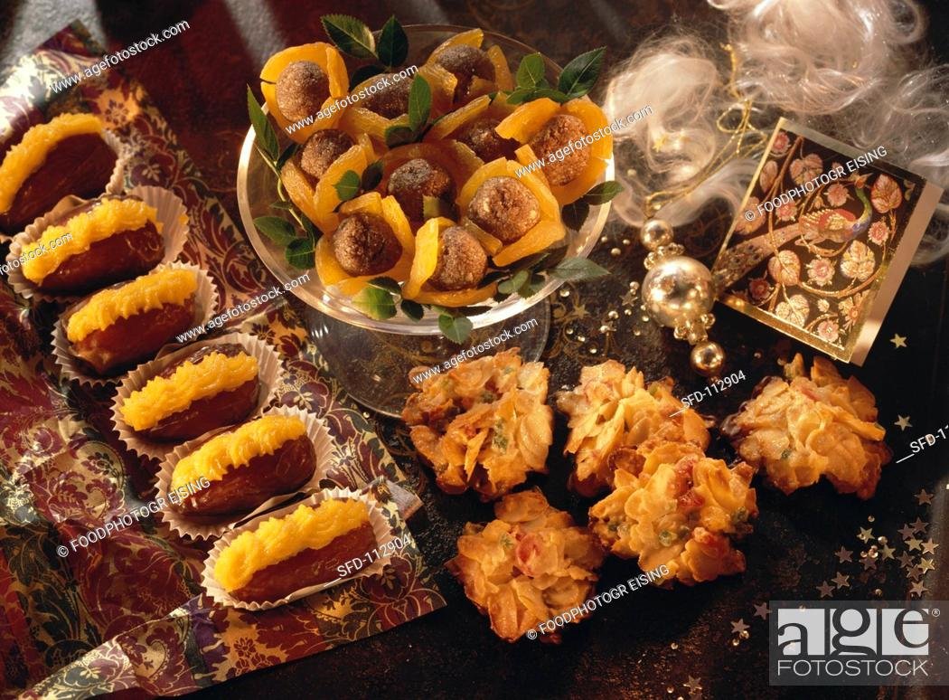 Stock Photo: Assorted Christmas Sweets with Christmas Decorations.