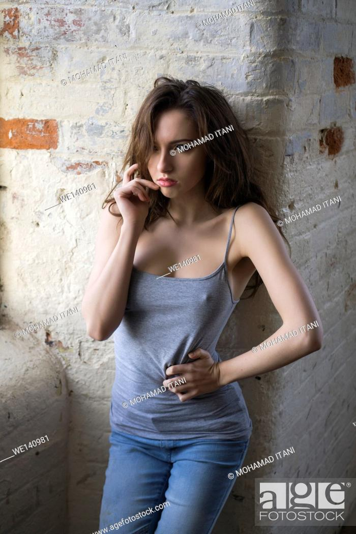 Stock Photo: Sexy young female standing by the window.