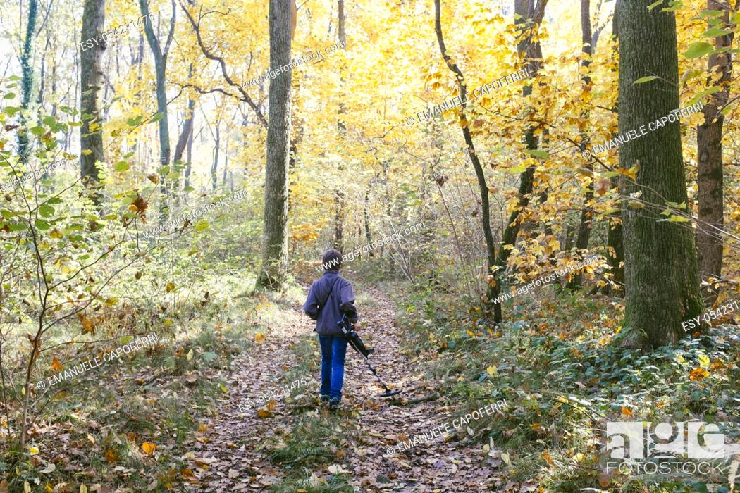 Stock Photo: Child with metal detector in the forest in autumn.