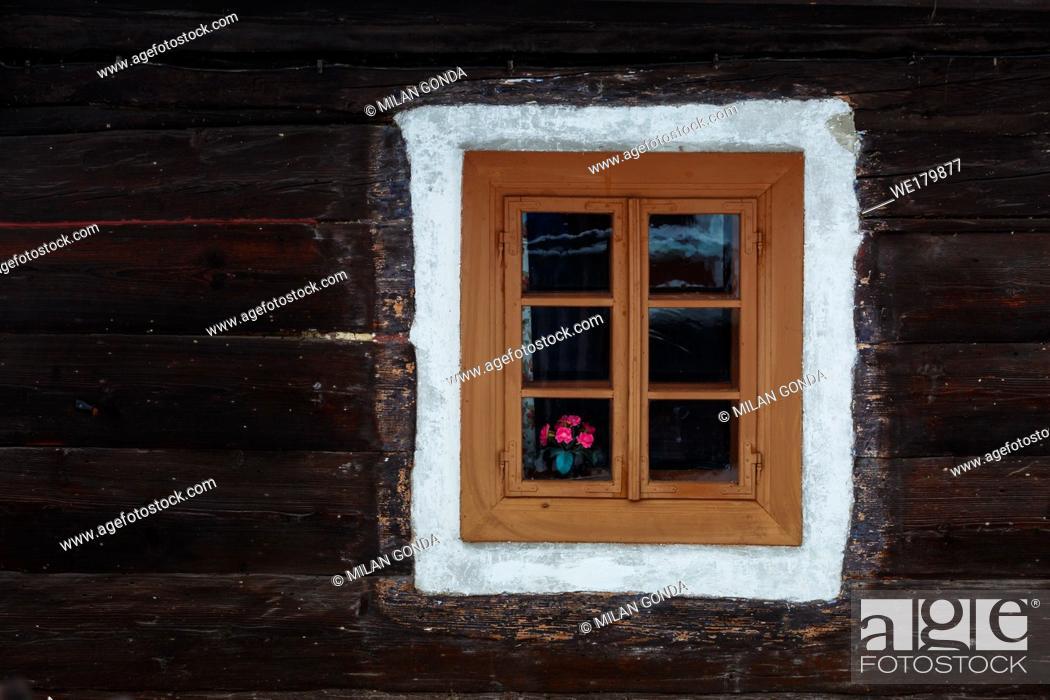 Stock Photo: Window of a traditional house in Turcianske Jaseno village, northern Slovakia.