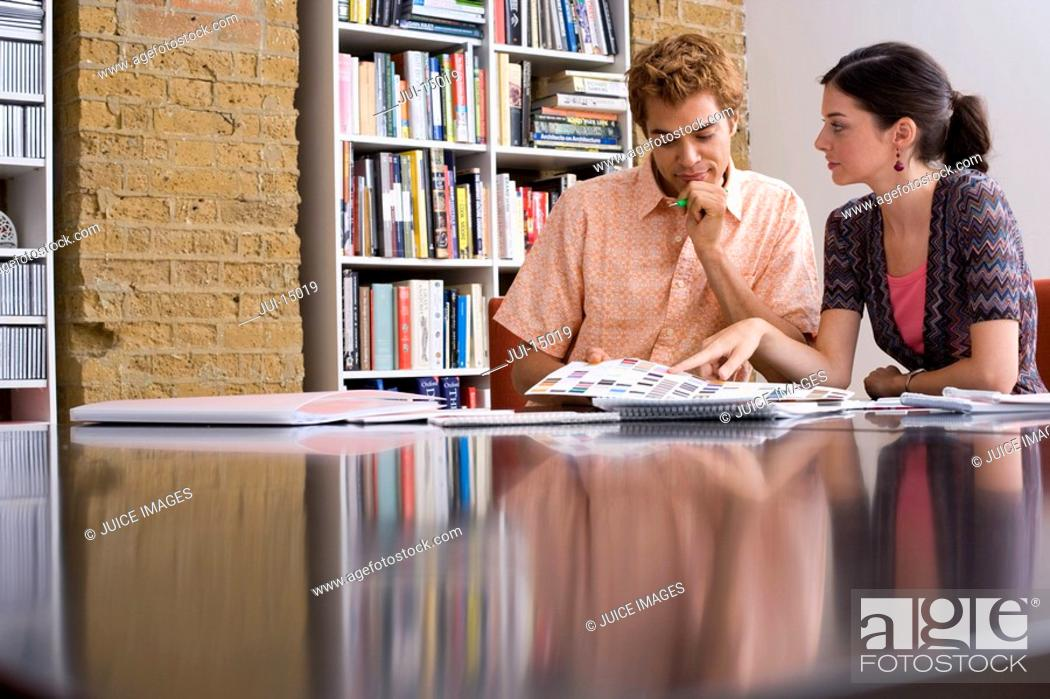 Stock Photo: Designer and colleague in meeting.