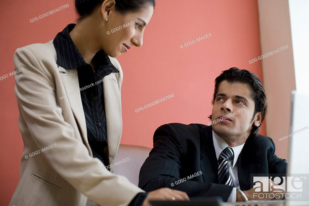 Stock Photo: Businesspeople at desk.