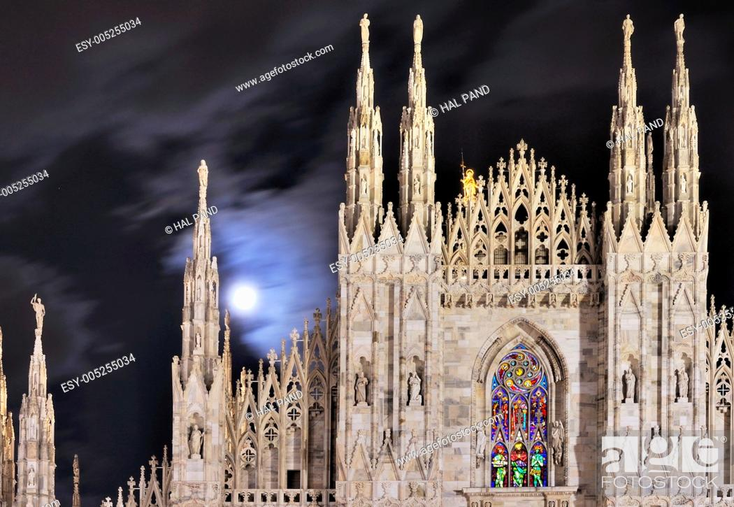 Stock Photo: Milan Italy 2011, 10, 12 cathedral windows illuminated for Christmas celebrations, shot at night under cloudy moon.
