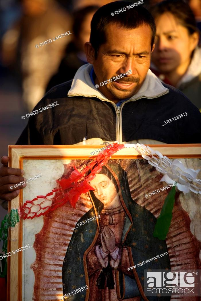 Stock Photo: A pilgrim carries an image of the Our Lady of Guadalupe in Mexico City, December 11, 2010  Hundreds of thousands of Mexican pilgrims converged on the Our Lady.