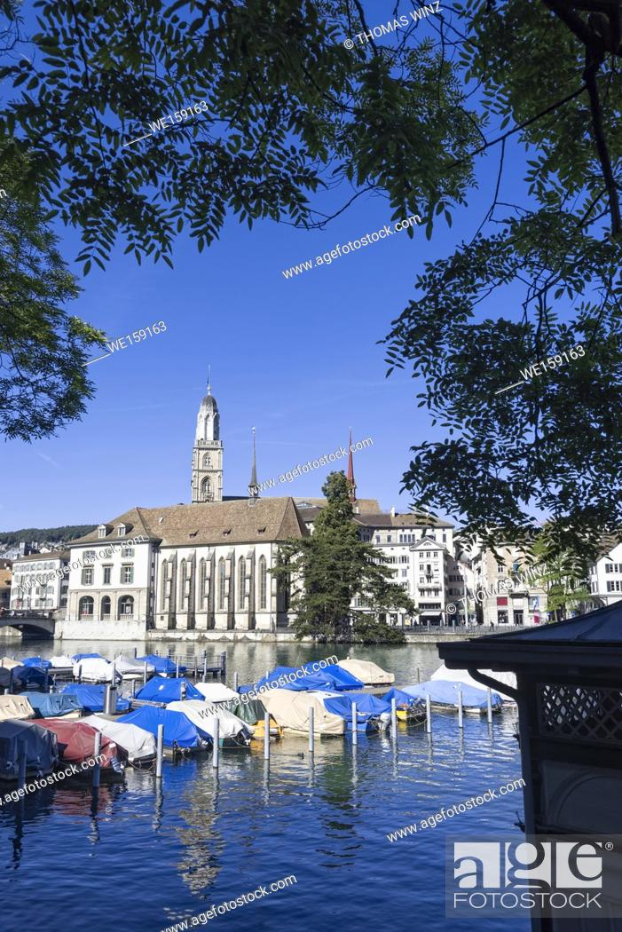 Stock Photo: Boats moored at River Limmat, Grossmünster Church in the distance, Zurich , Switzerland.