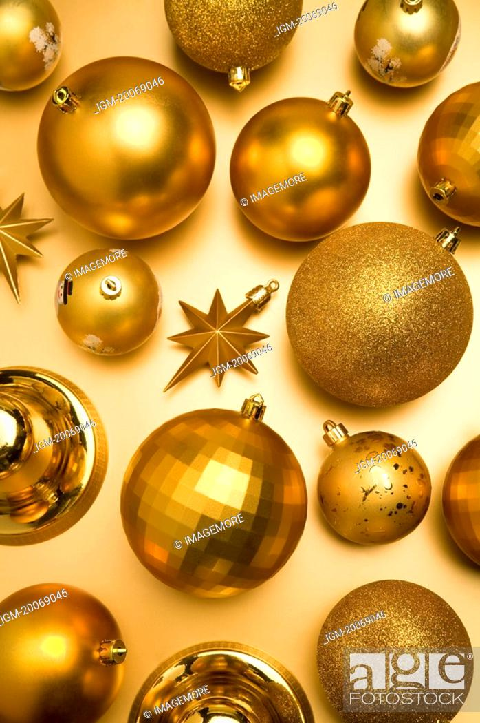 Stock Photo: Golden Christmas baubles.