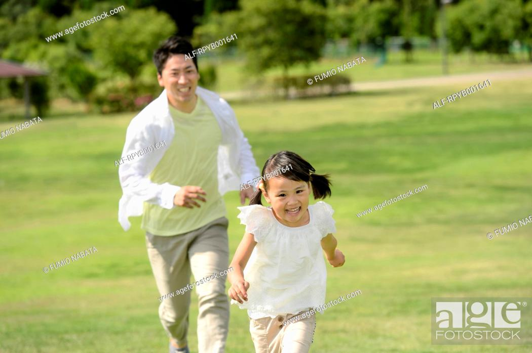 Stock Photo: Kid with dad at the park.