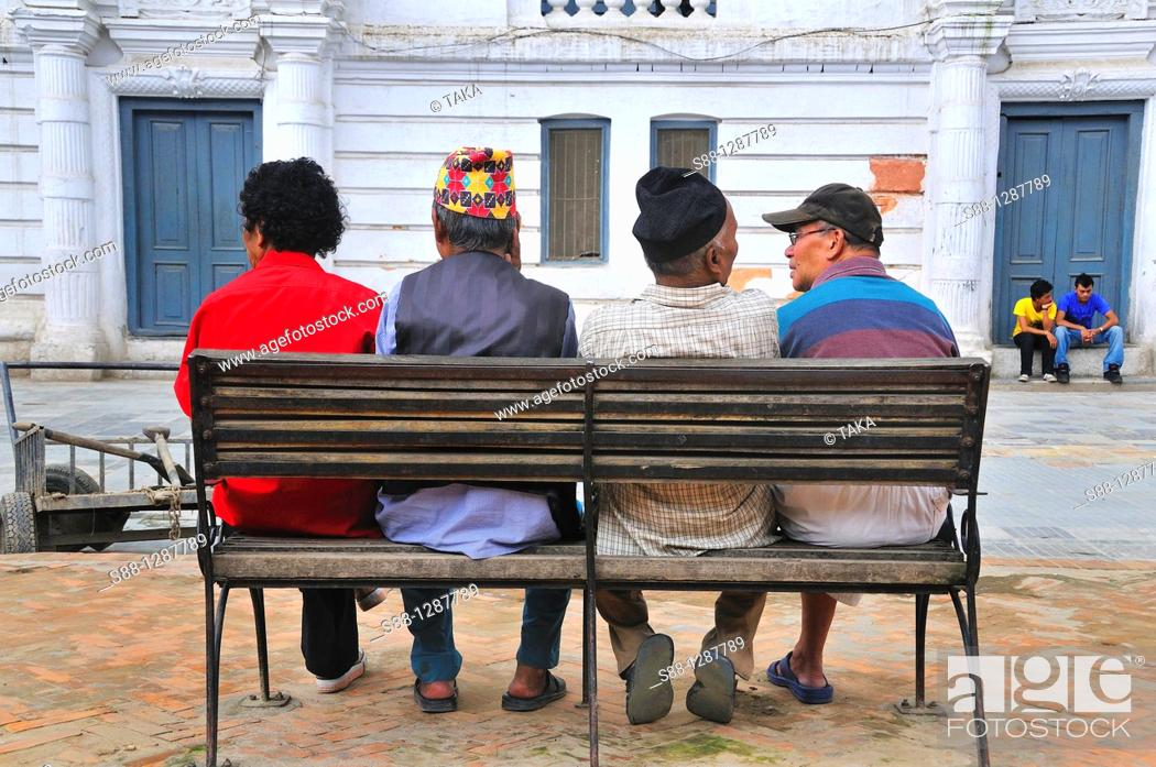 Stock Photo: Local friends talking together. Dabali Square, Basantapur, Nepal.
