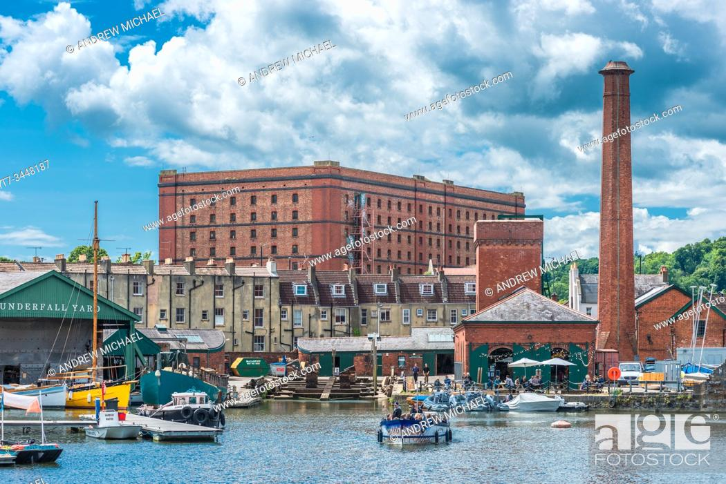 Stock Photo: Floating Harbour at Underfall Yard with Victorian pump room & an old tobacco warehouse to the rear, Bristol, Avon, England, UK.