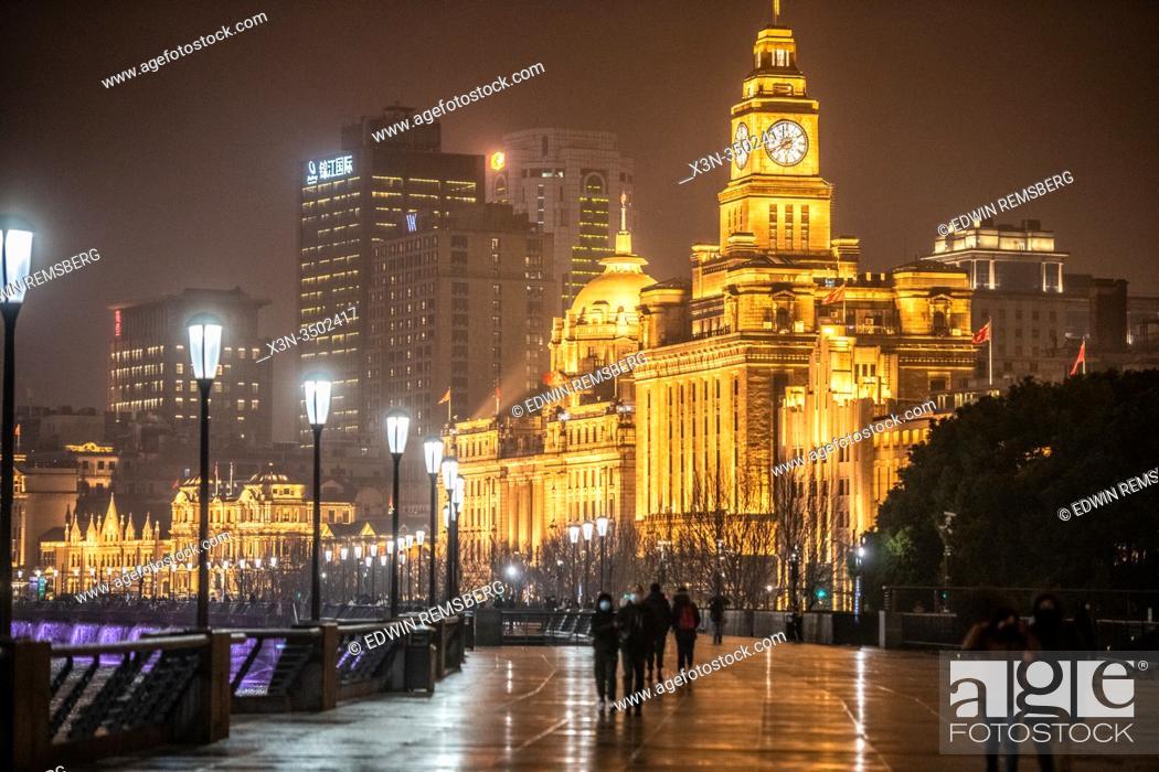 Stock Photo: The bright lights from the Bund illuminating the surrounding area , Shanghai, China.