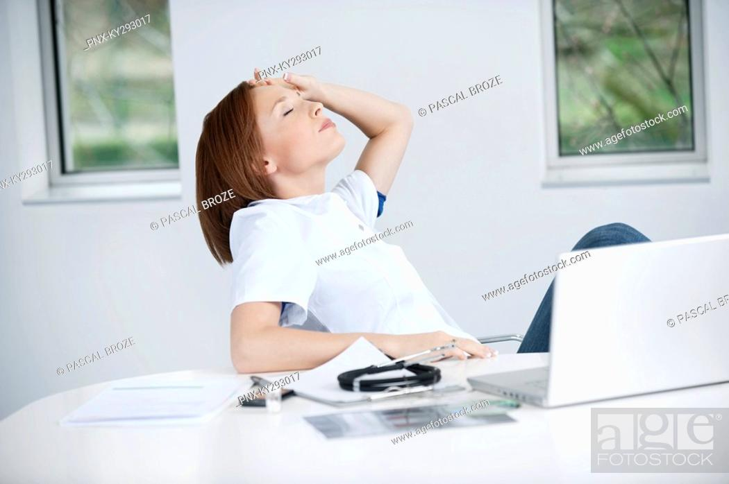 Stock Photo: Female doctor resting in an office.