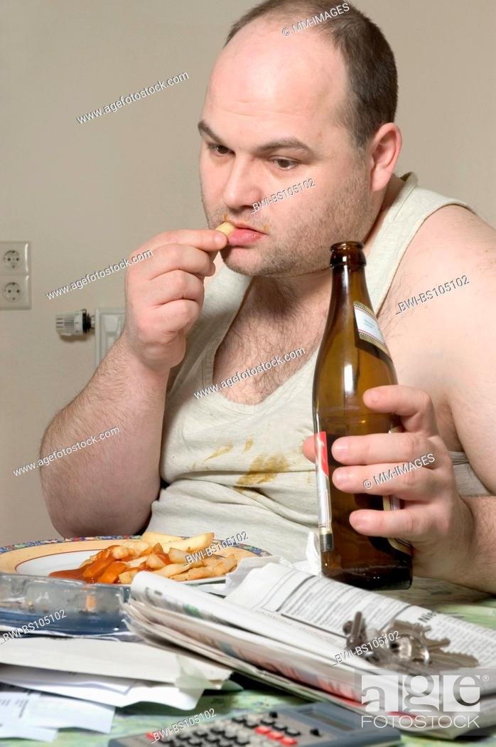Stock Photo: man in undershirt eating french fries and drinking beer, Ruhr Area.