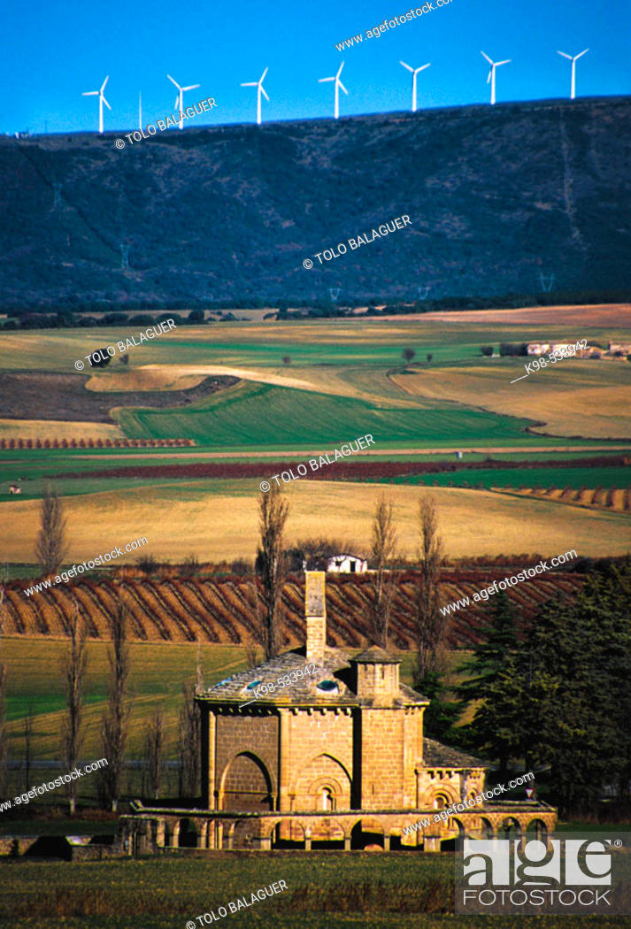 Stock Photo: Santa Maria de Eunate (Romanico s.XII) y parque eolico del perdon al fondo. Muruzabal. Navarra. Spain.