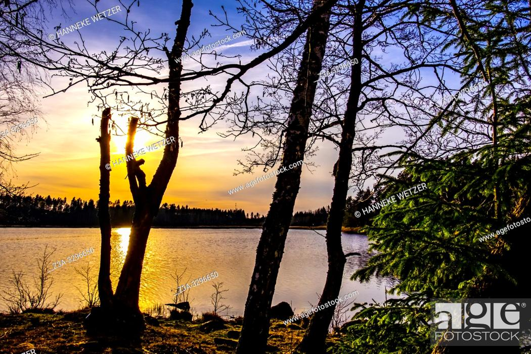 Stock Photo: Sunset at al ake in Sweden.