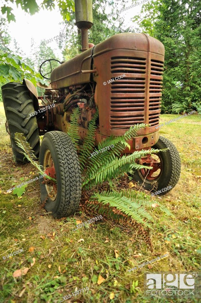 Stock Photo: old, abandoned farm tractor near Cherry Point, Vancouver Island, British Columbia, Canada.