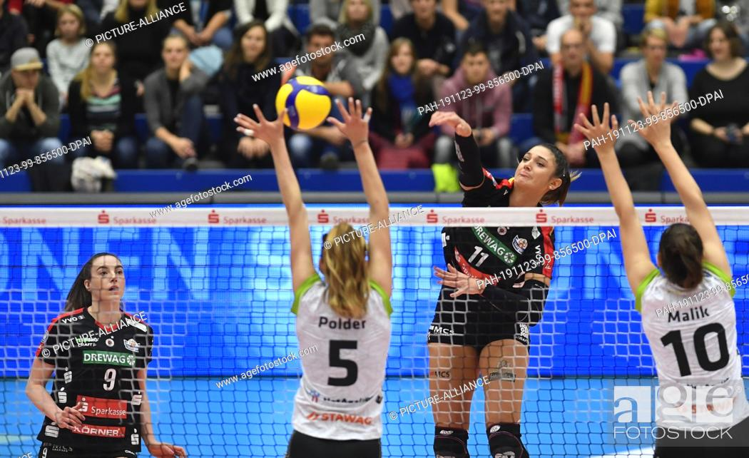 Stock Photo: 23 November 2019, Saxony, Dresden: Volleyball, women: DVV Cup, Dresdner SC - Ladies in Black Aachen. Dresden's Milica Kubura (rear).