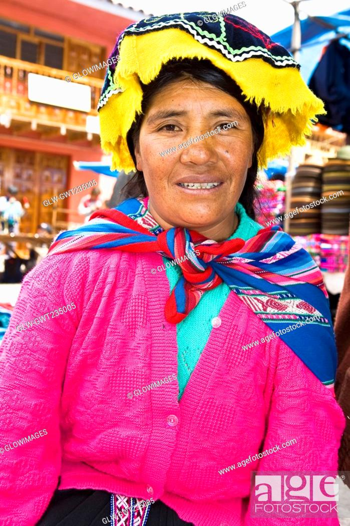Stock Photo: Portrait of a mid adult woman sitting and smiling, Peru.