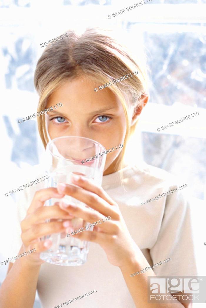 Stock Photo: Girl drinking.