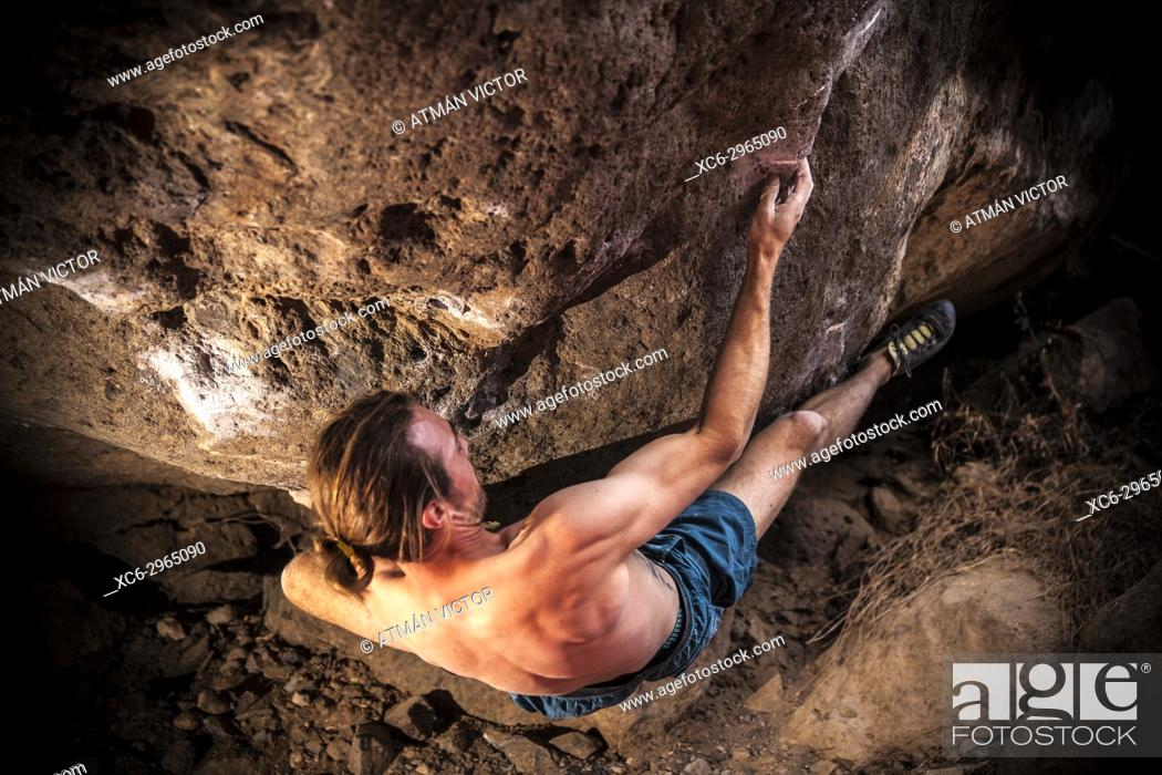 Stock Photo: rock climber bouldering in Arico, Tenerife, Canary Islands, Spain).