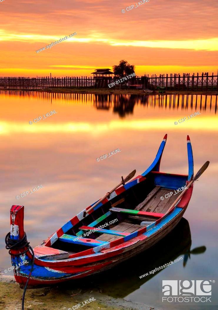 Stock Photo: Wooden boat in Ubein Bridge at sunrise, Mandalay, Myanmar.