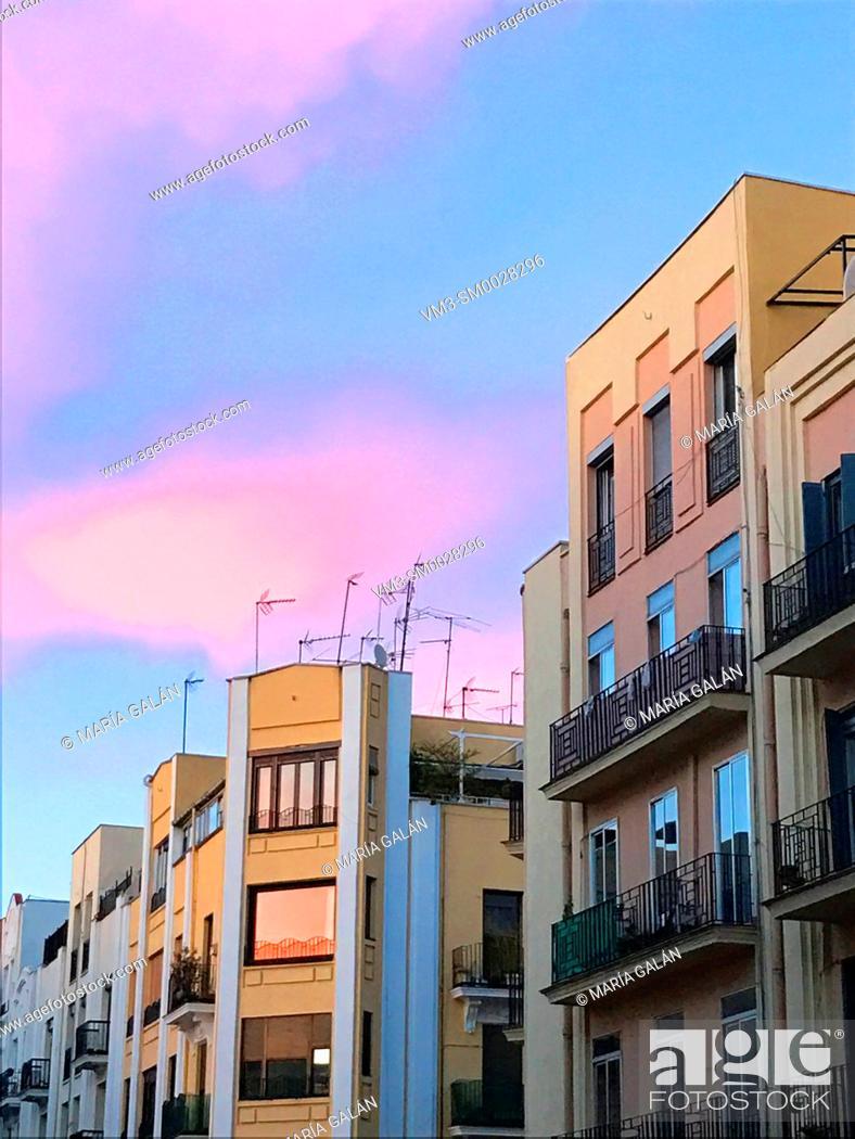 Stock Photo: Facade of houses at dusk. Lope de Rueda street, Madrid, Spain.