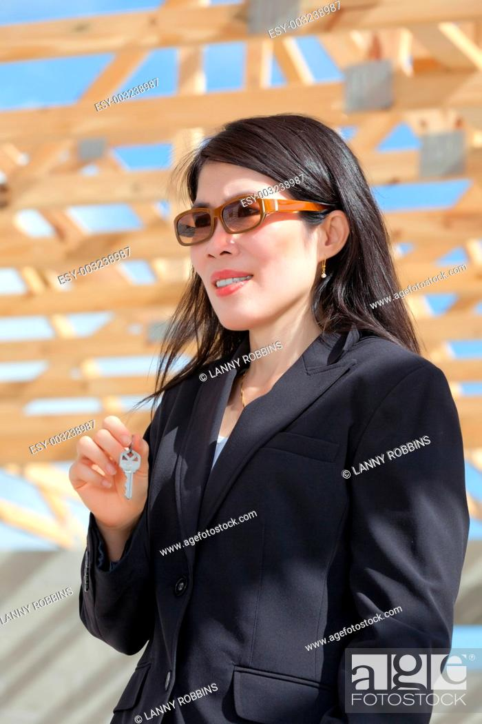 Stock Photo: Asian woman contractor with a set of keys.