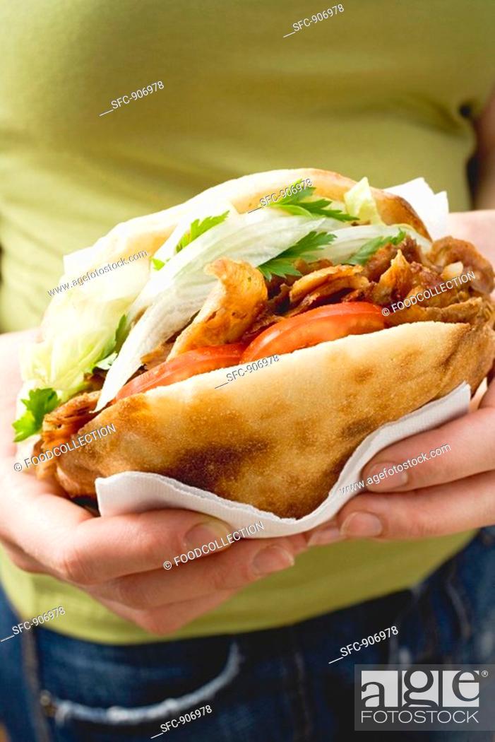 Stock Photo: Hands holding a döner kebab.