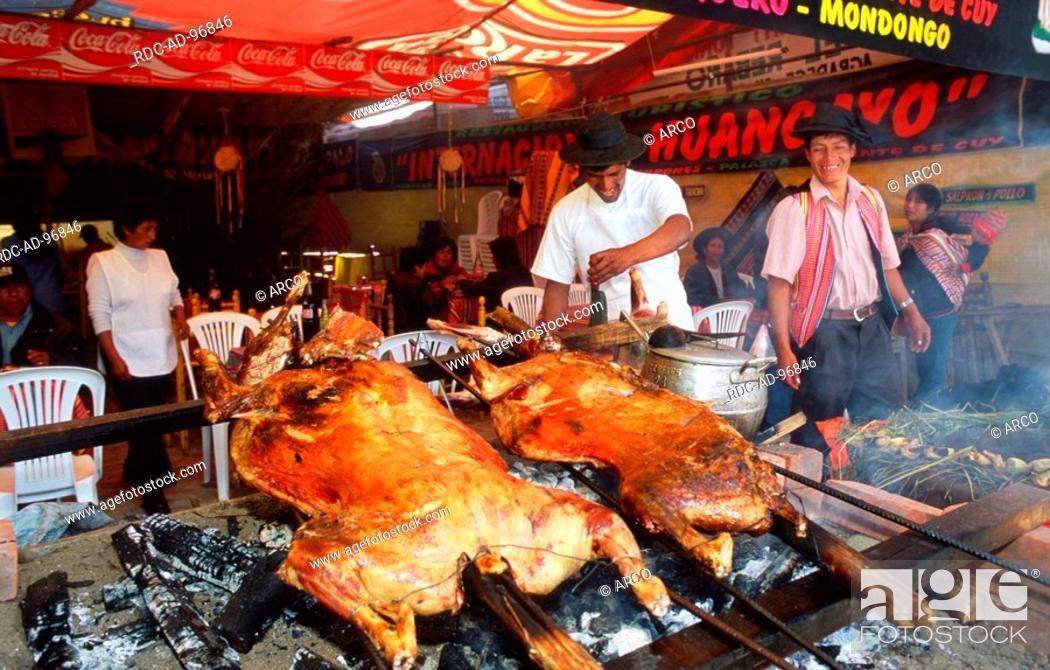 Men Making Barbecue At Market Stall Conception Near Huancayo Peru