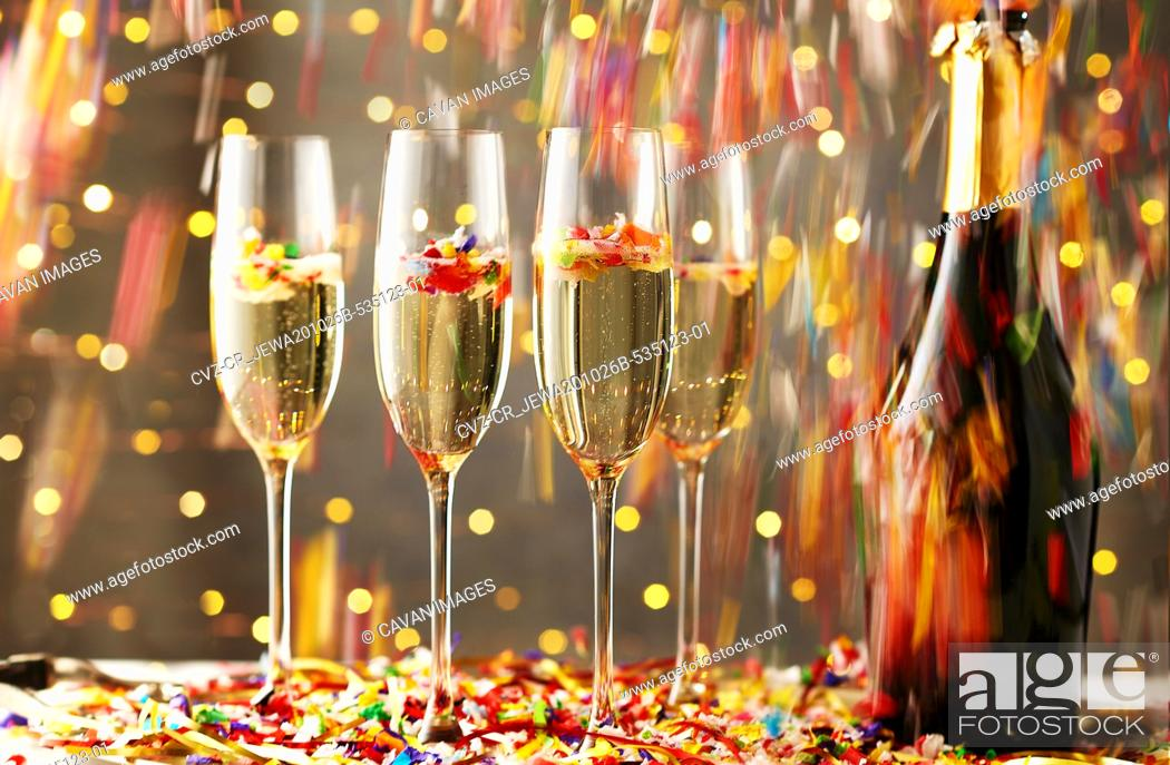 Stock Photo: Flutes of Champagne with Confetti.