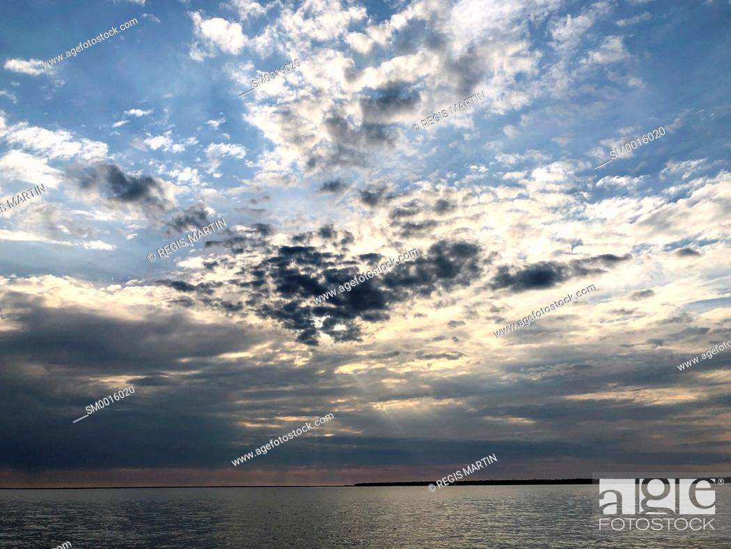 Stock Photo: clouds over the shore of Darwin Harbour.