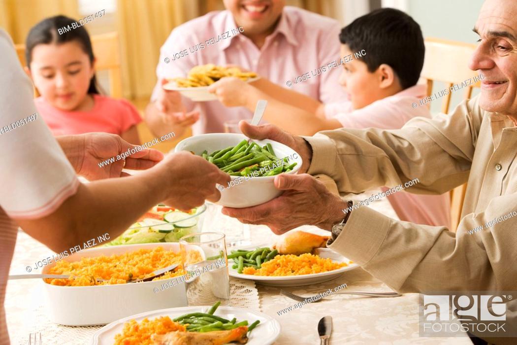 Stock Photo: Hispanic family at dinner table.