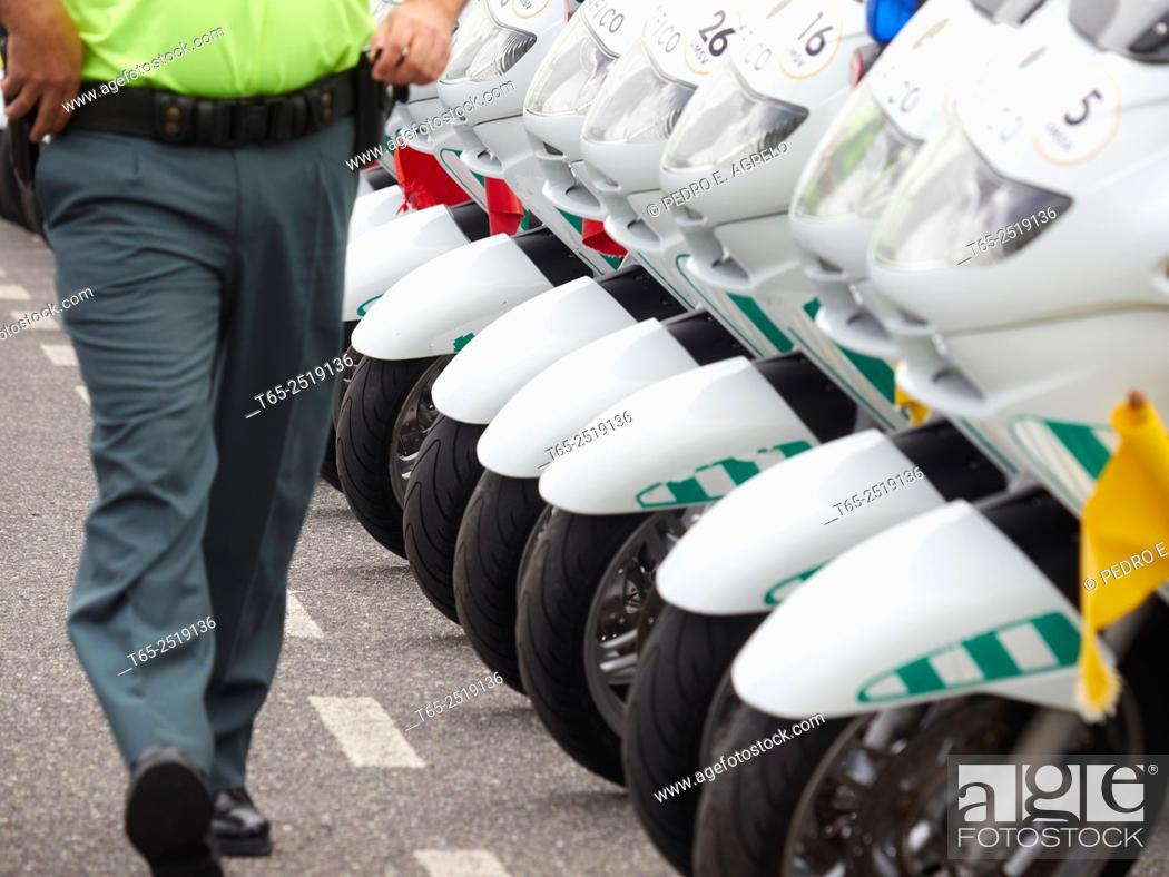 Stock Photo: Lugo departure from the city of Lugo in the first stage XIV cyclist Volta a Galicia 2015. The image formation support the motorcycle policeman.