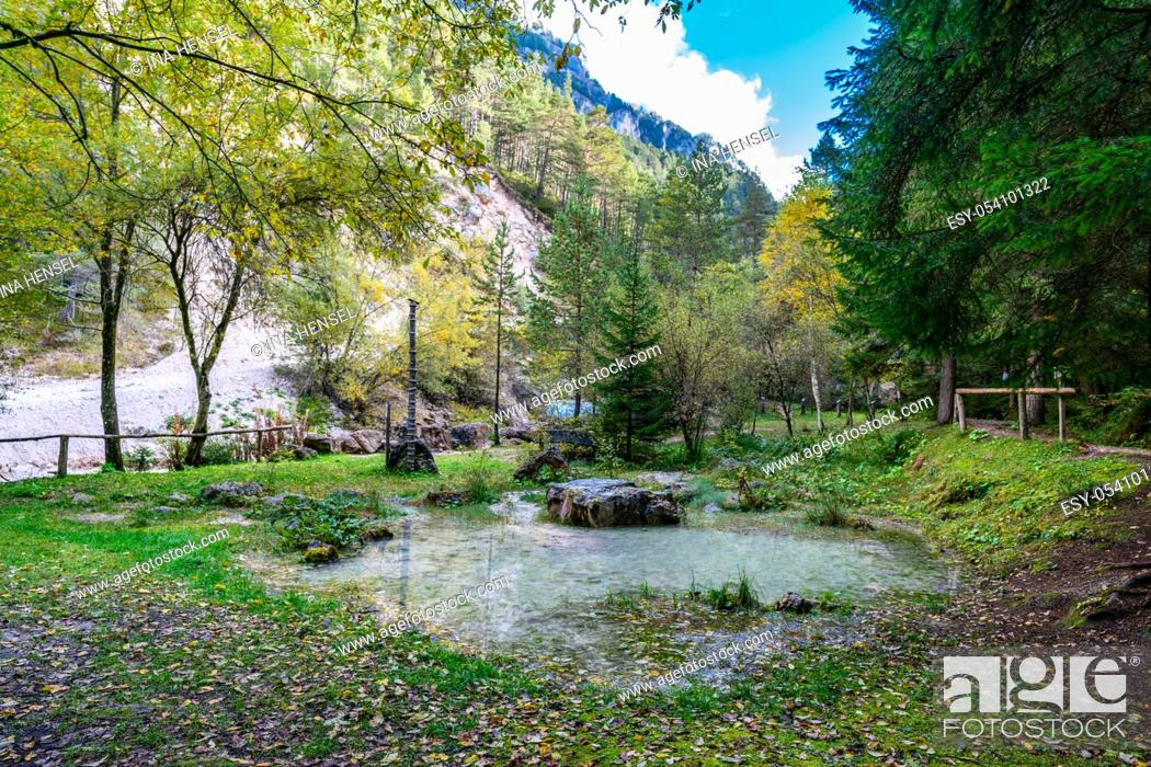 Stock Photo: Beautiful view of the outdoors exhibition of the naturparkhaus Schlern-Rosengarten museum with the Tschaminbach river in the background on a bright autumn day.