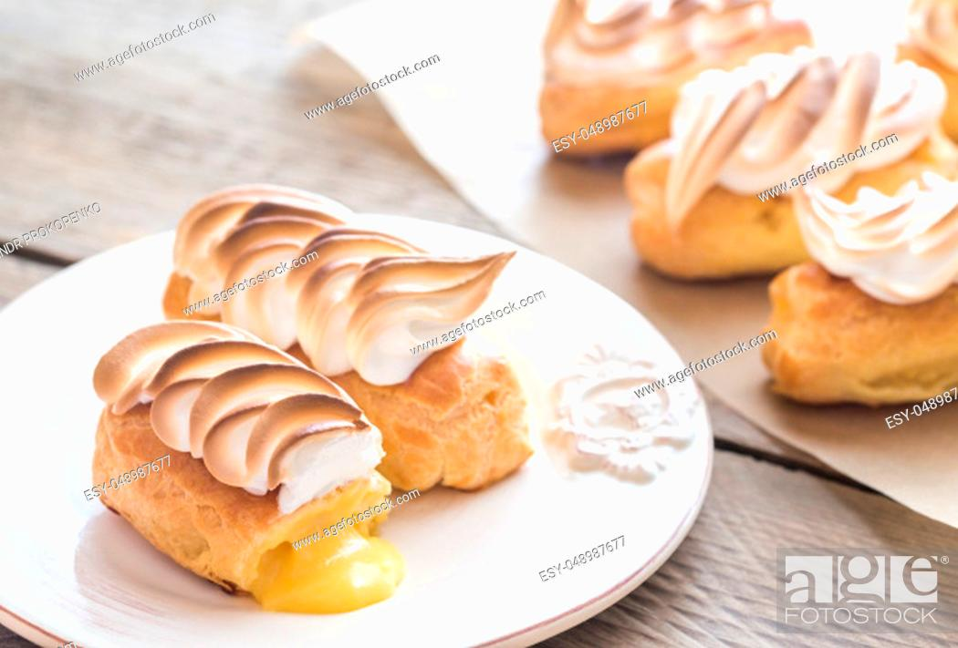 Stock Photo: Eclairs with lemon curd and meringue.