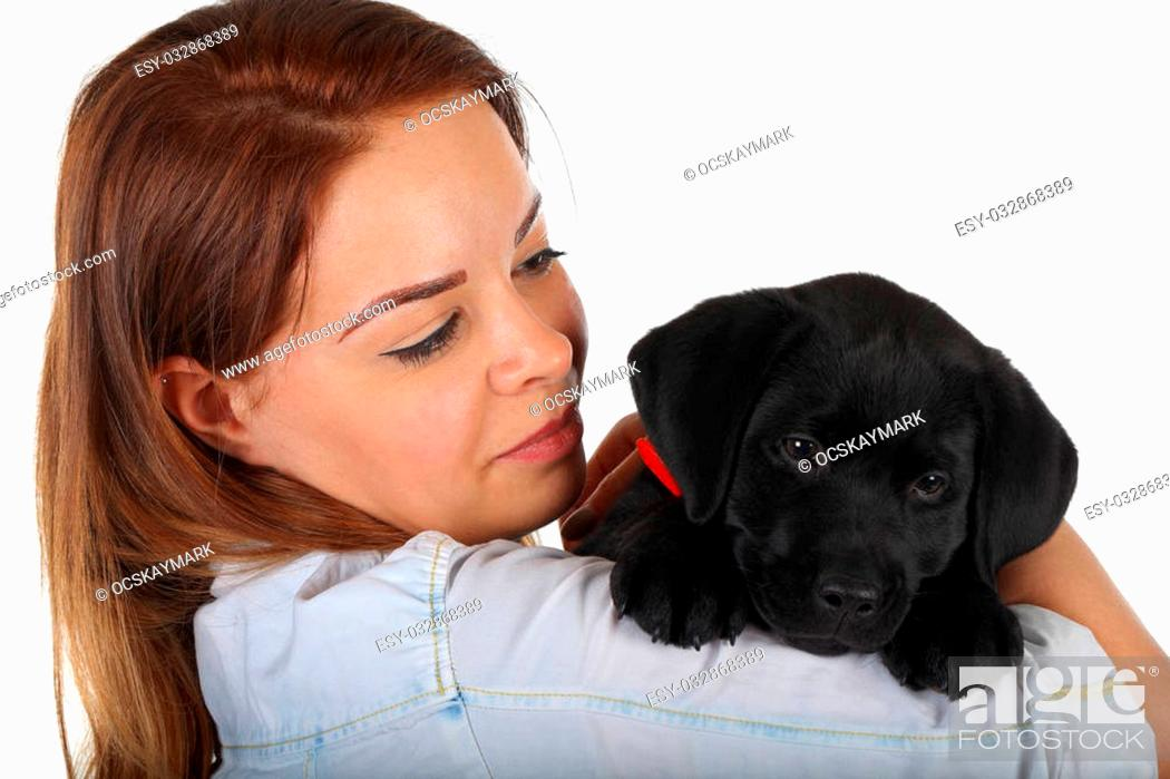 Stock Photo: Picture of a woman with her black labrador puppy.