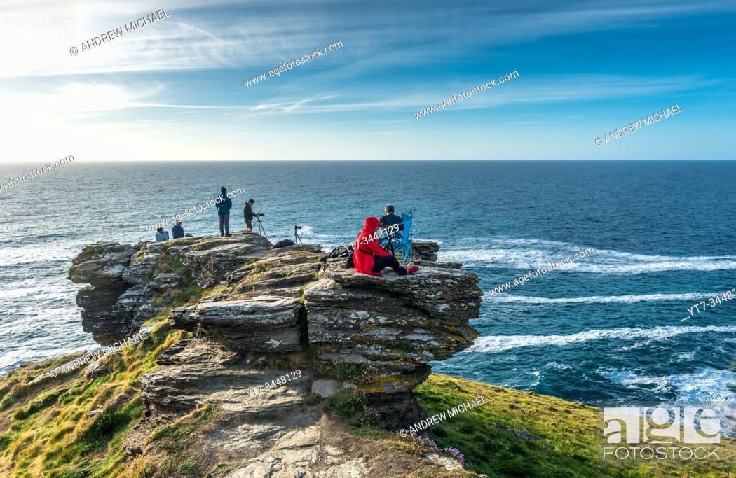 Stock Photo: Photographers at Tintagel waiting for the sunset on the Cornish coast. Cornwall, England, UK.