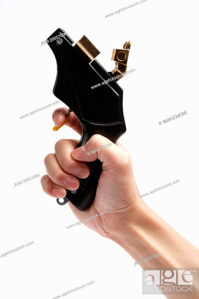 Stock Photo: Human hand holding a starting gun.