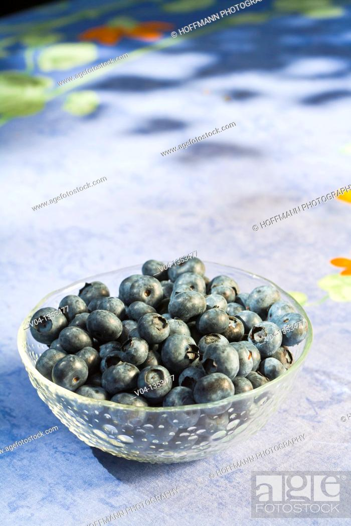 Stock Photo: A glass bowl filled with delicious blueberries.