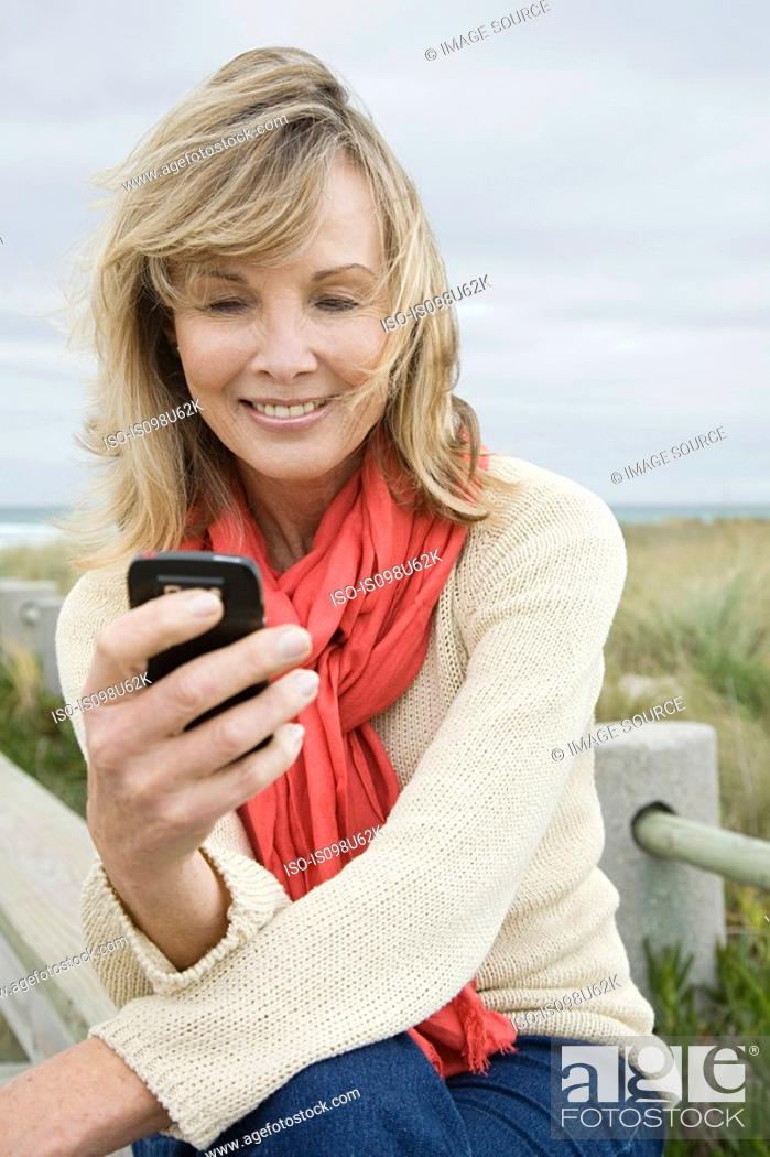 Stock Photo: Woman using cellphone.
