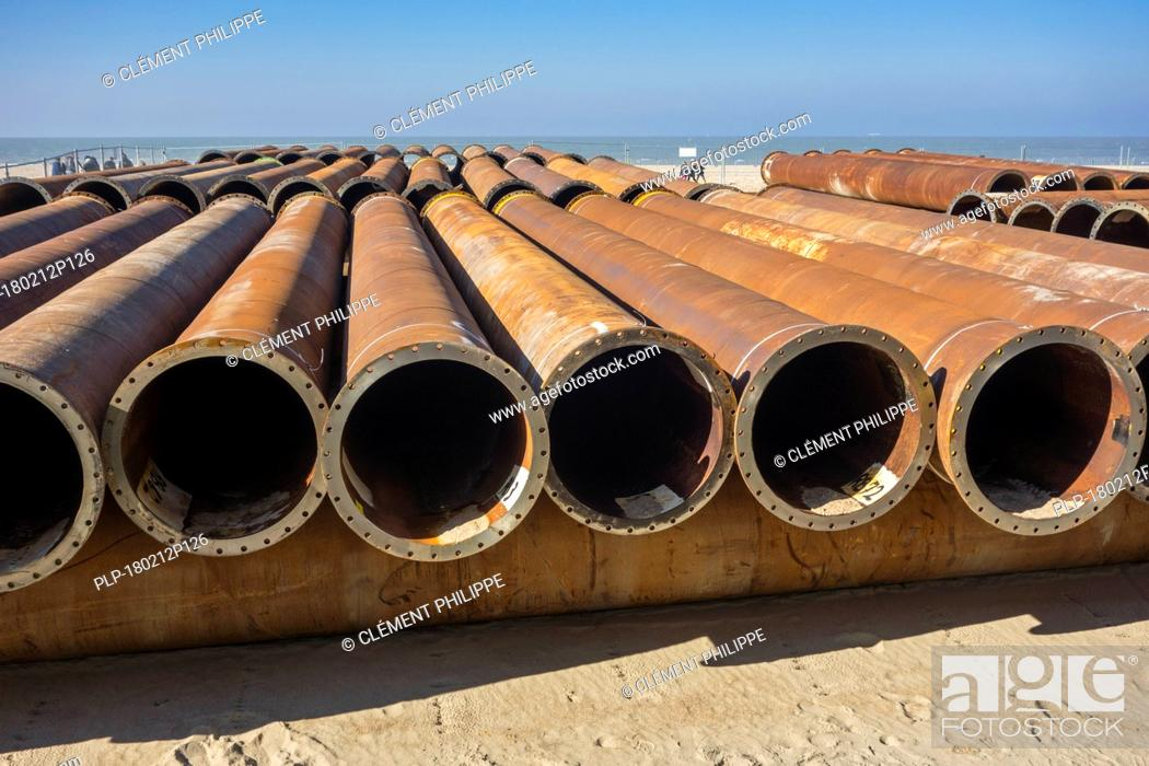 Stock Photo: Pipeline tubes for sand replenishment / beach nourishment to make wider beaches to reduce storm damage to coastal structures.
