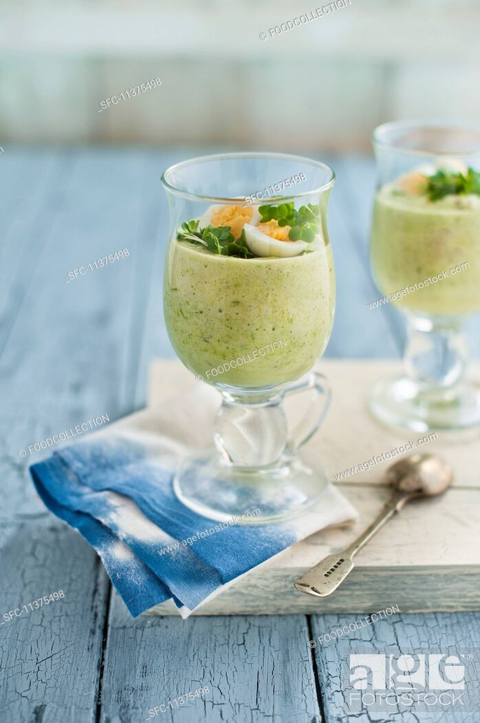 Stock Photo: Asparagus mousse in glasses with quail's egg and cress.