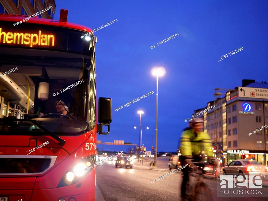 Stock Photo: STOCKHOLM SWEDEN Hornstull section of town Bus and cyclist Public transport.