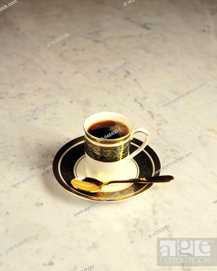Stock Photo: Overhead view of cup of coffee on floor.