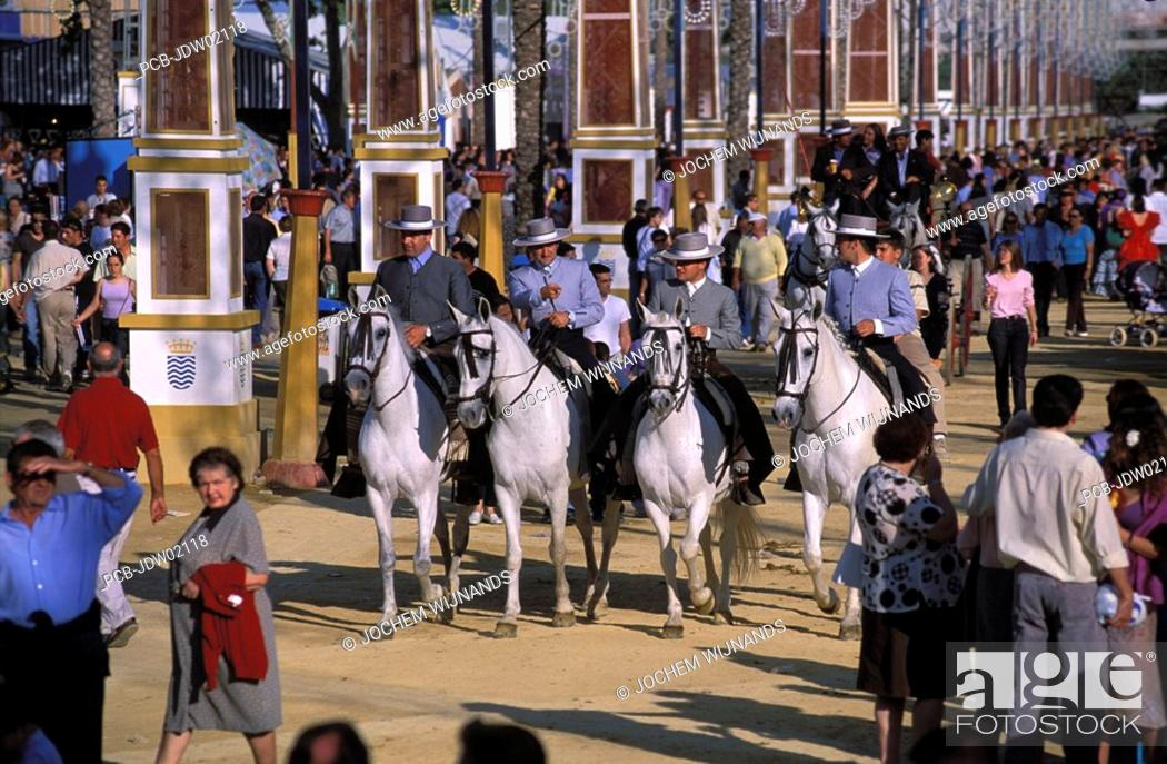 Stock Photo: Jerez de la Frontera, caballeros parading on their horses at the Feria del caballo.