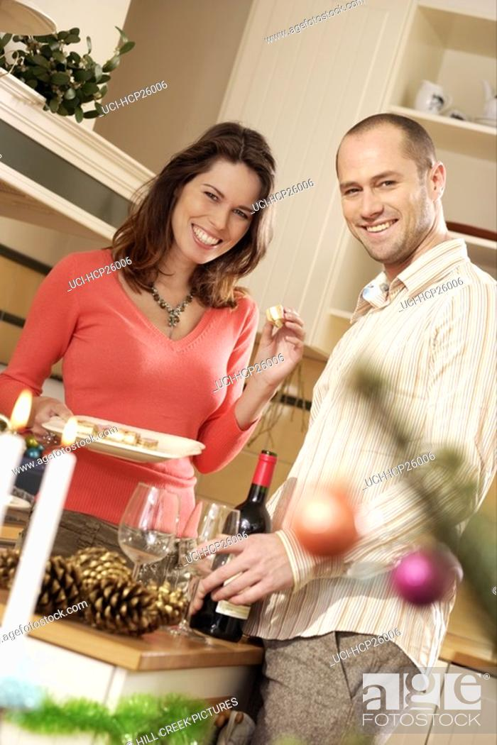 Stock Photo: Couple smiling in the kitchen.