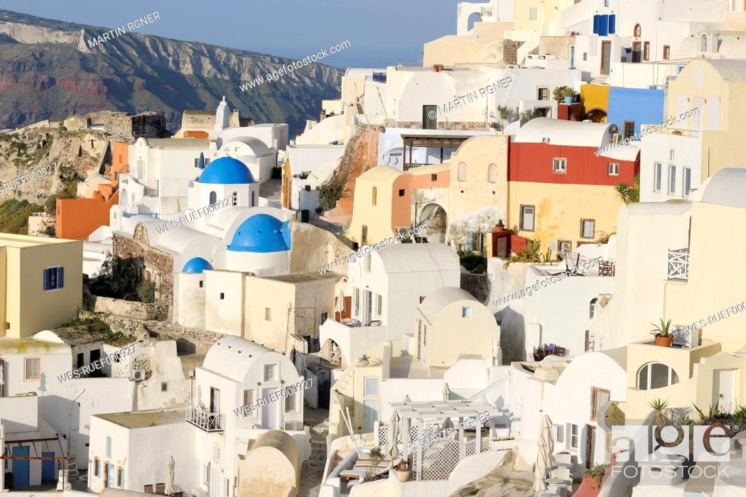 Stock Photo: Greece, View of classical whitewashed church in Oia village.