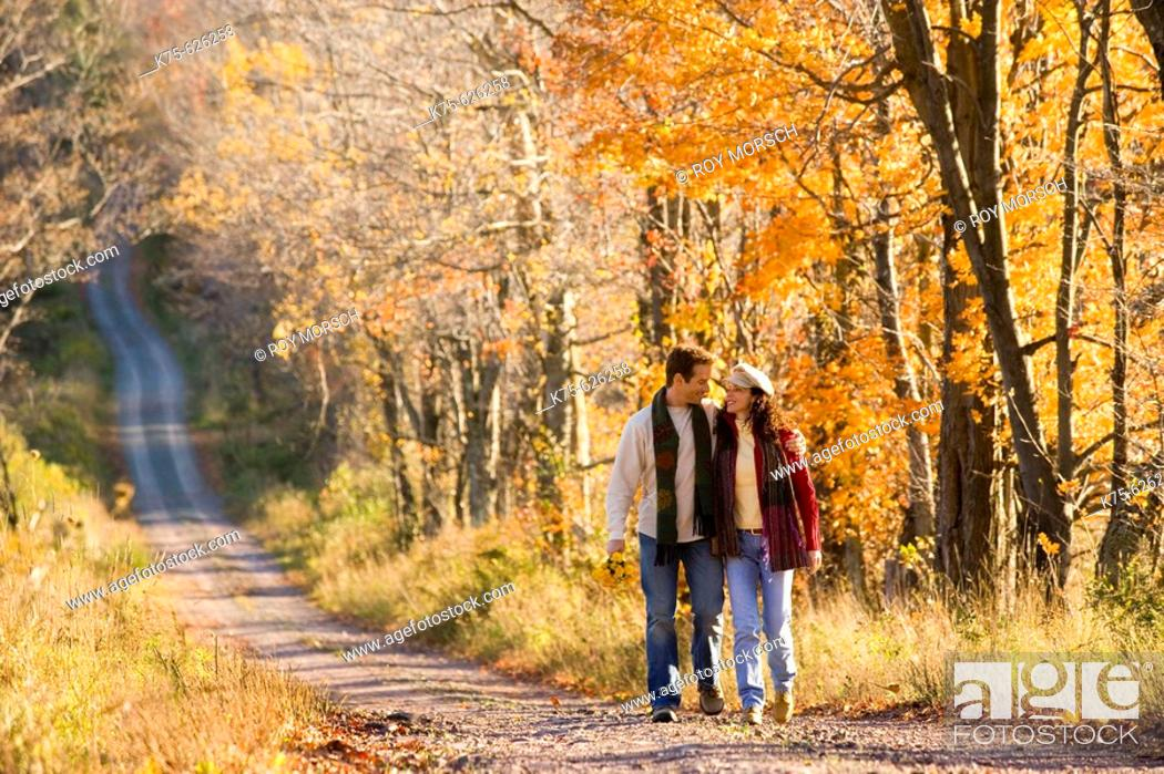 Stock Photo: Caucasian couple, age 30's to 40's, country road, smiling, walking, hugging.