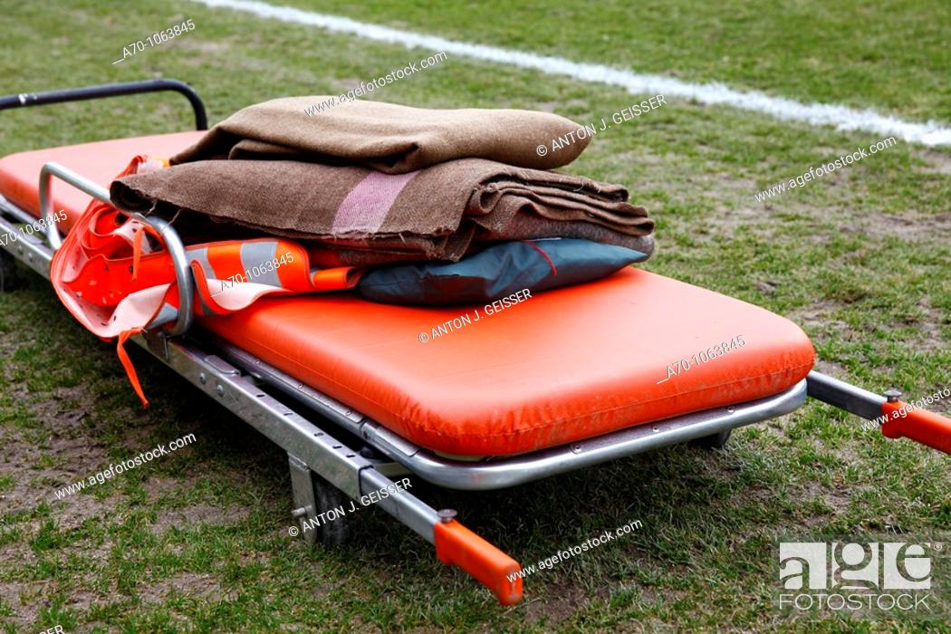 Stock Photo: Soccer game , stretcher on football pitch.